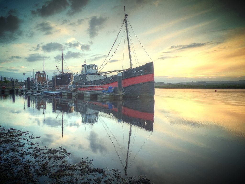 pontoon at irvine harbour with MV Kyles and Puffer Spartan alongside with sunset in background